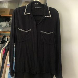 Black blouse with collar, pocket and wrist detail